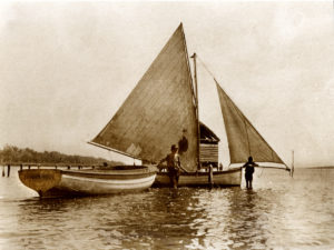 Ron Daw with boat and sailboat